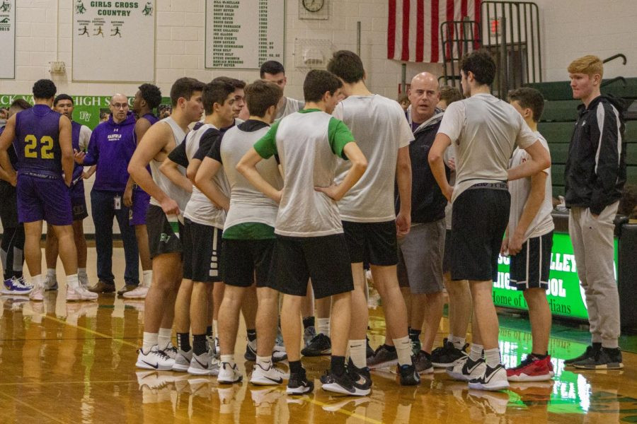 Head coach Al Coleman talks to the team during its scrimmage against Garfield.
