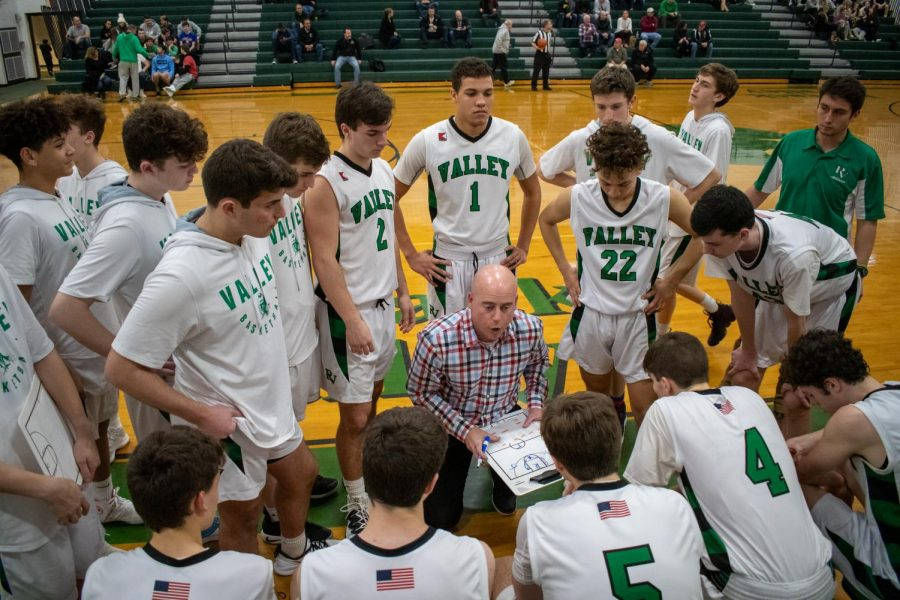 Boys basketball coach Al Coleman talks to his players during a timeout
