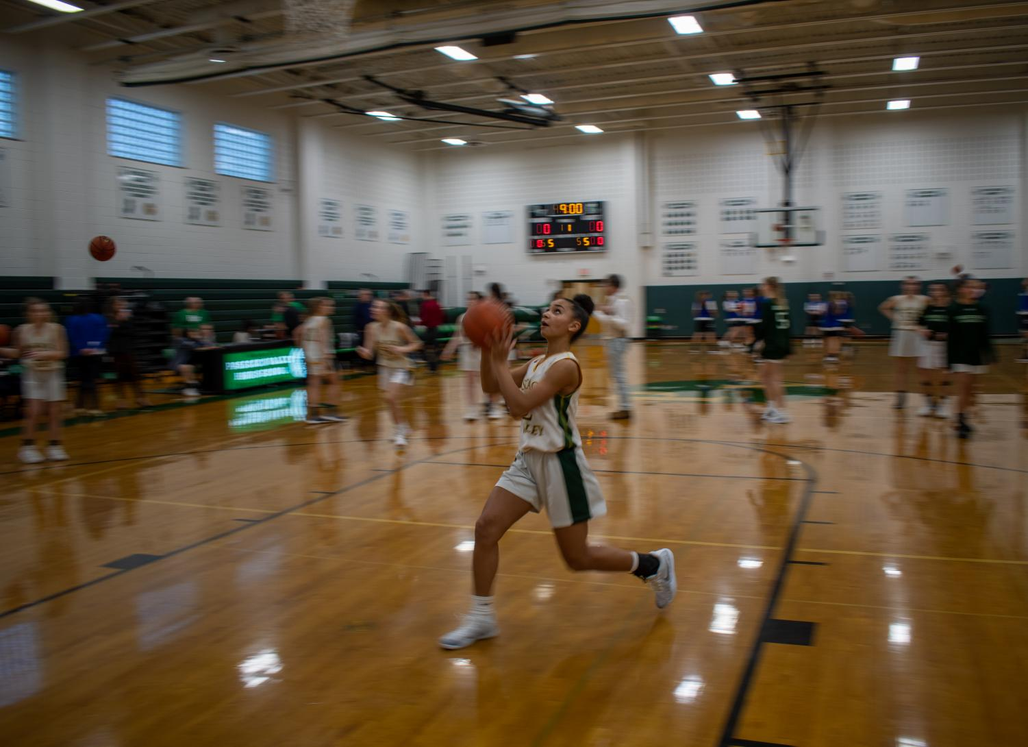 Freshman Lindsay Jennings drives to the basket for a layup before the girls basketball game against Northern Valley Demarest on Thursday, Jan. 16.