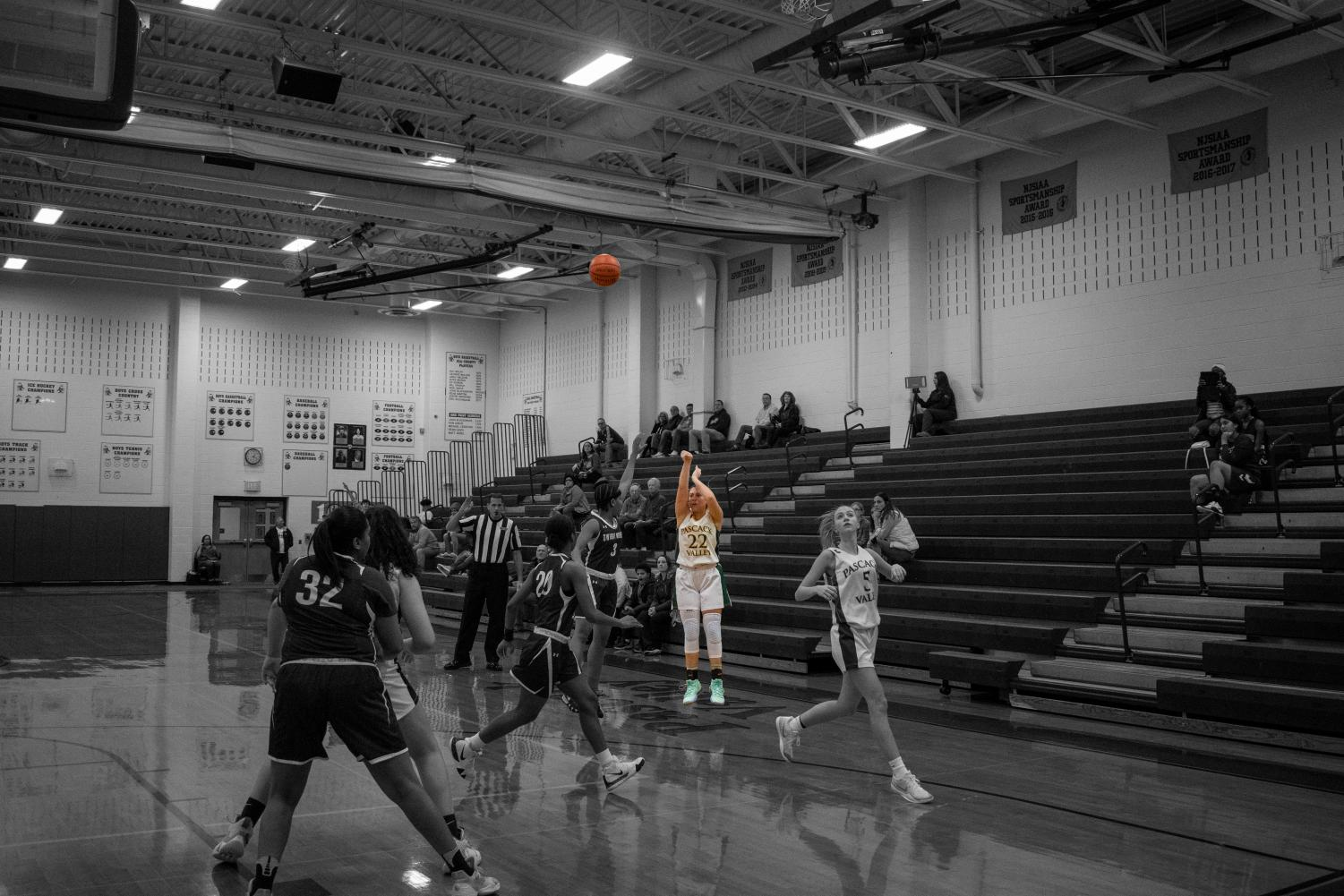 Sophomore Jules Vassallo splashes a three-pointer to seal the game against Dwight Morrow on Thursday, Jan. 2.