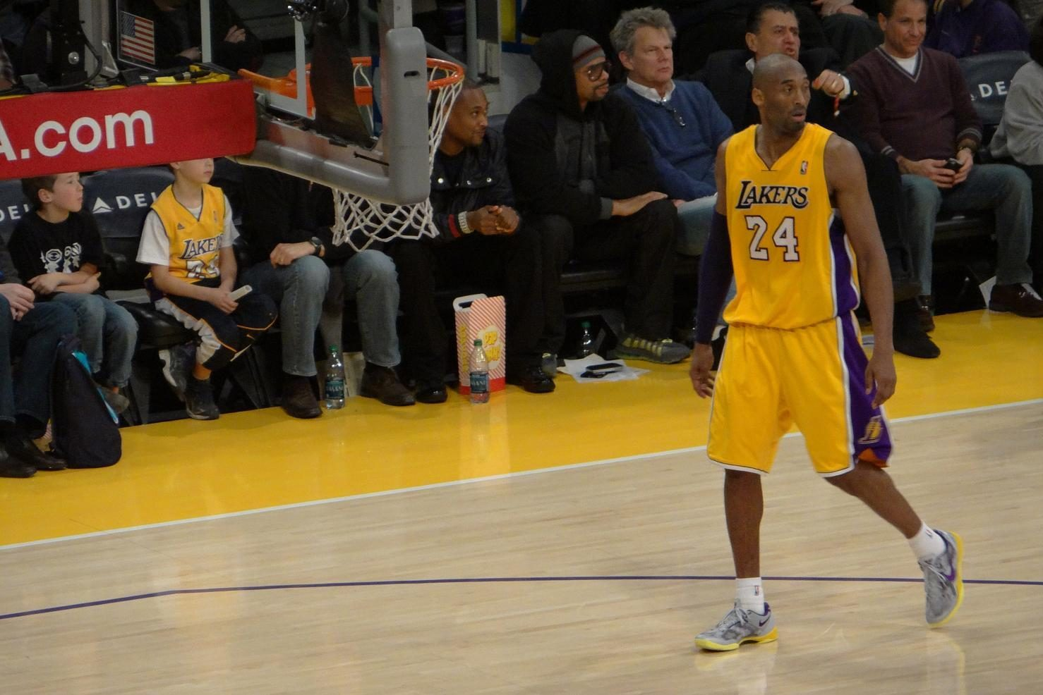 Kobe Bryant approaches the Lakers' bench in a 2013 home game against the Bucks. Bryant died Sunday in a helicopter crash at age 41.