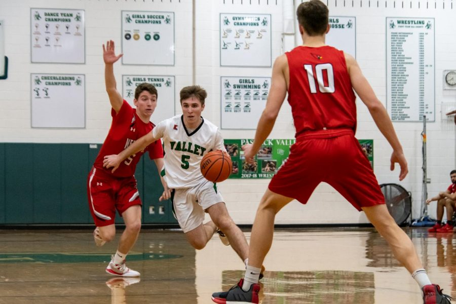Jake Wolf dribbles through the defense. The PV boys basketball team begins its season later than expected.