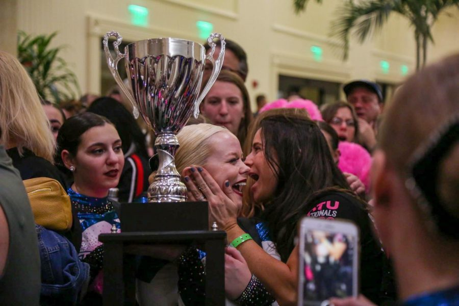 Senior dance team captain Sarah Viceconte holds the trophy after winning the National Championship in Small Pom.