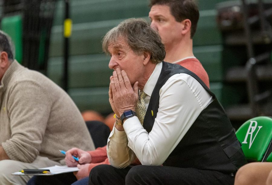 Coach Jeff Jasper attentively watches his team.