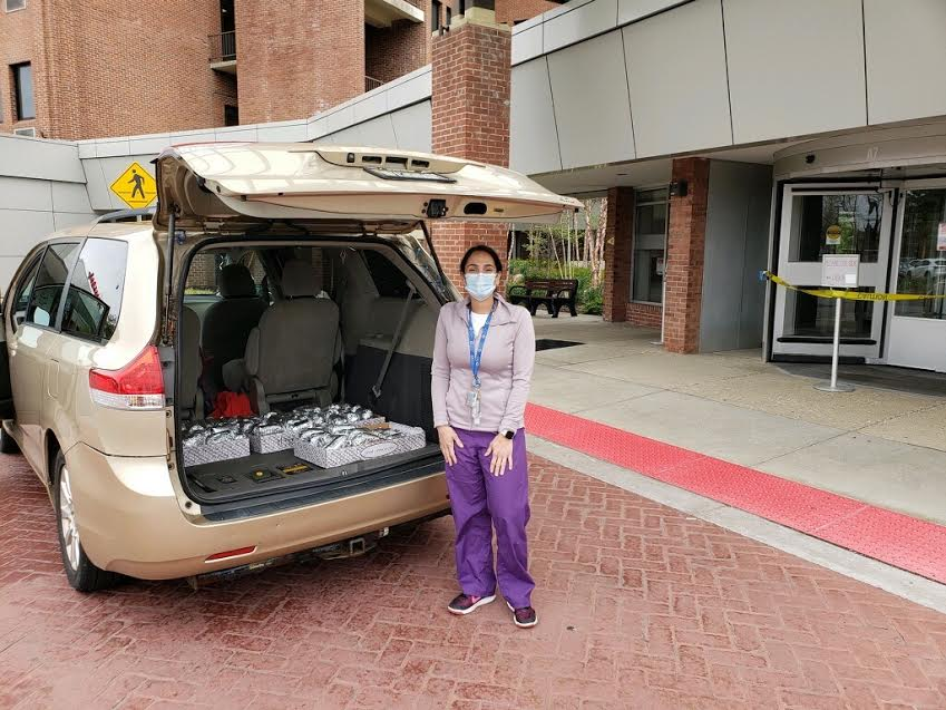 A nurse picks up meals delivered to the hospital from Ridgemont Pizza & Restaurant in Park Ridge. Pascack Hills teachers Virena Rossi, Kaitlyn Mahaffey, Charleen Schwartzman, and Deb Horn created a GoFundMe page to provide meals for healthcare workers at Hackensack Meridian Pascack Valley Medical Center in Westwood.