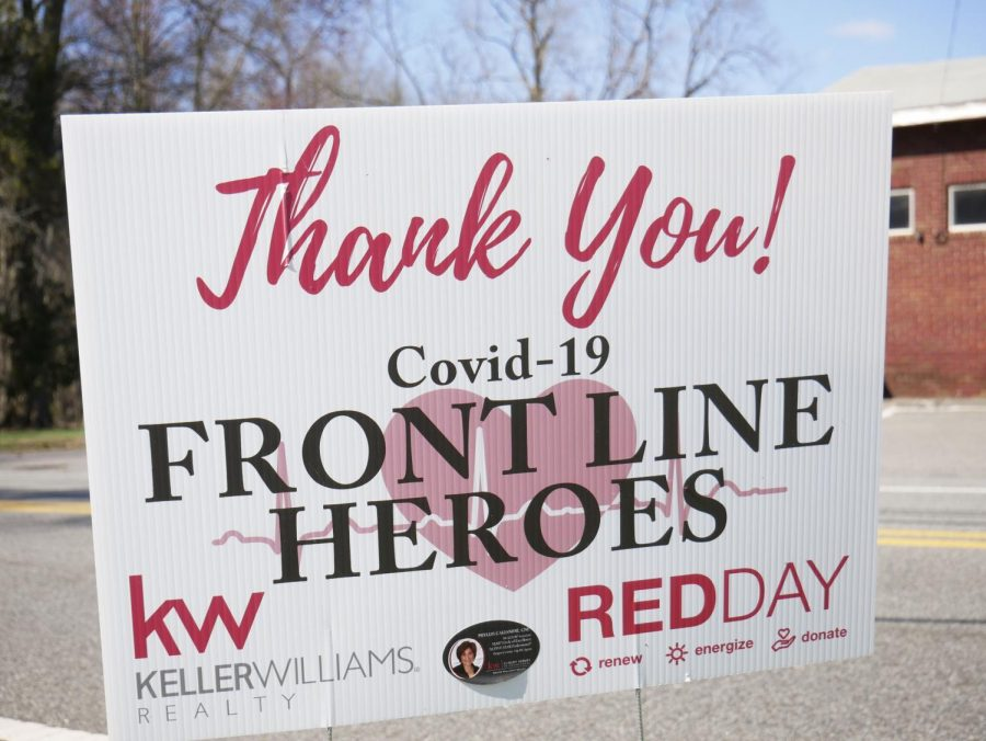 A lawn sign thanks medical professionals and personnel on the frontlines of the pandemic. Many can be found throughout the surrounding towns.