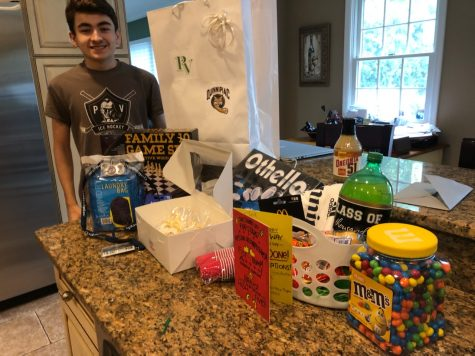 "Senior Jeff Patalano receives goodies from his adopter. Community members were given the opportunity to ""adopt"" and give gifts to a senior of their choosing from a Facebook group."