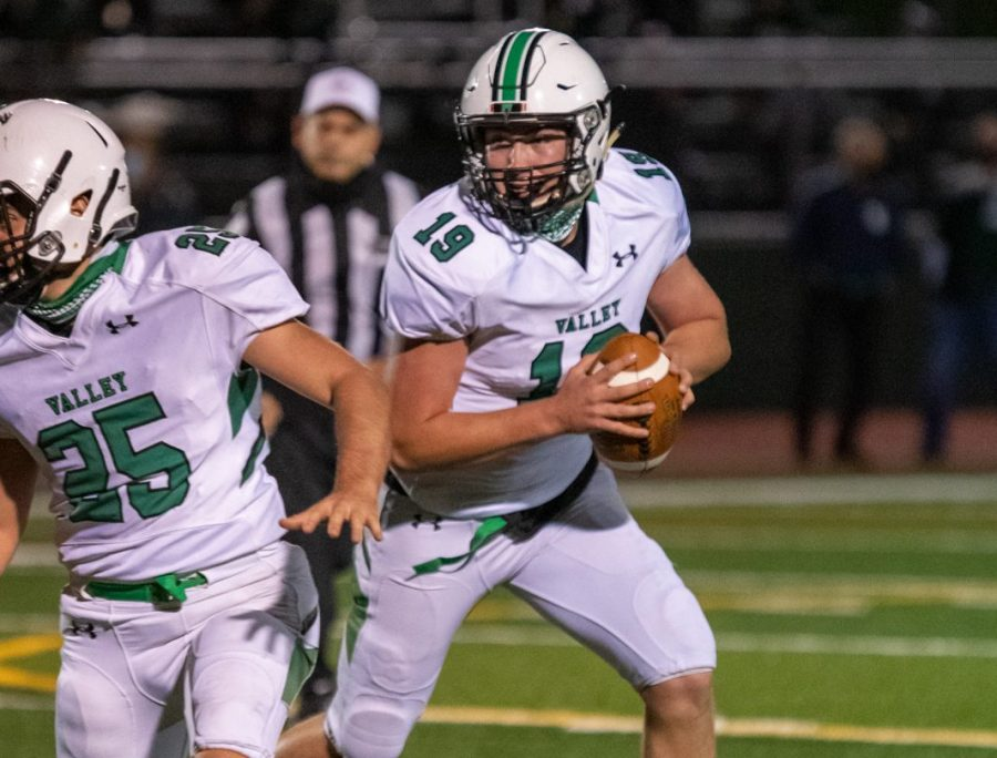 Quarterback Zach Traina rolls out of the pocket against Ramapo. He totalled 79 total yards in his first varsity start last week.