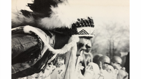 A PV student wears an Indian headdress during a football game in the 1963 yearbook. A group of staff writers created a package looking into the history behind PV