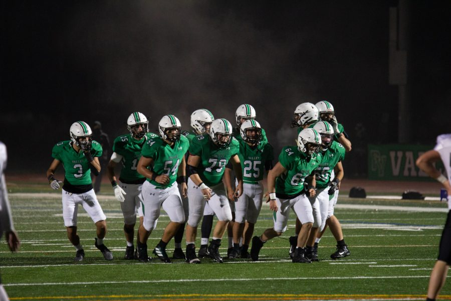 Pascack Valley's offense breaks its huddle. PV will host Paramus Friday night in its final game of the season.