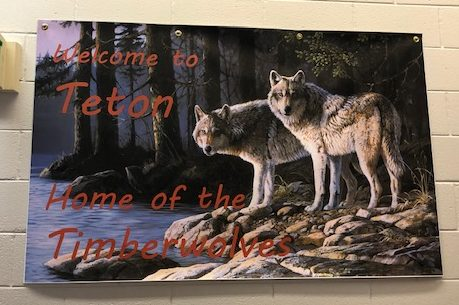 A banner displaying Teton High Schools new Timberwolf mascot and nickname. The Timberwolf mascot was approved in June of 2020, replacing the schools Redskin mascot.