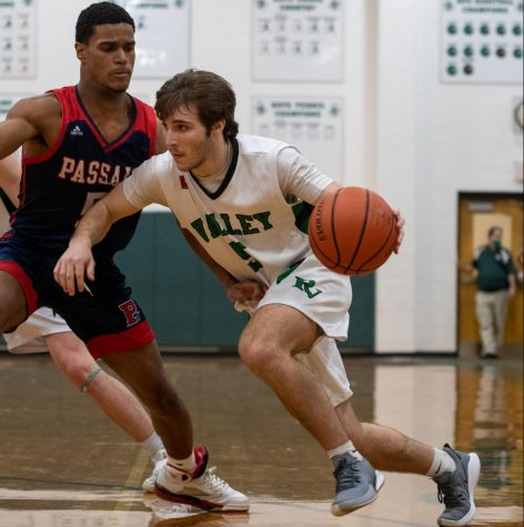 Jake Wolf attempts to get by the defender. Pascack Valley defeated Passaic Valley at home by a score of 52-41 Thursday night, and Wolf is the Athlete of the Week.