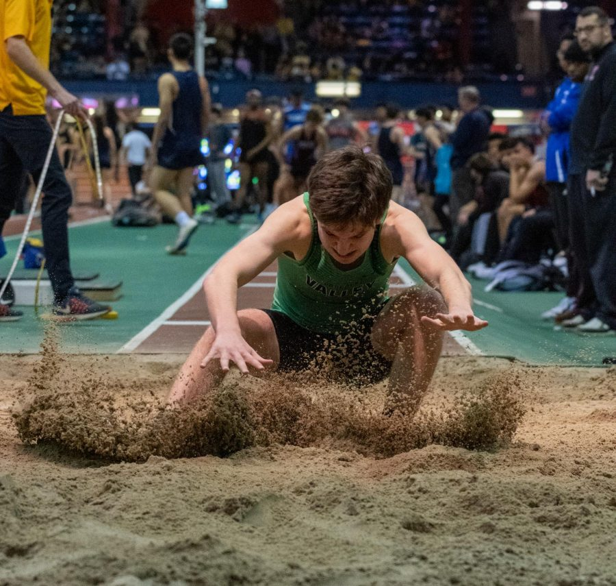 Senior Joe Mercurio attempts to stick the landing in the long jump pit. The winter track team looks to have similar success to last year, when its Sprint Medley Relay reached the New Balance Nationals.
