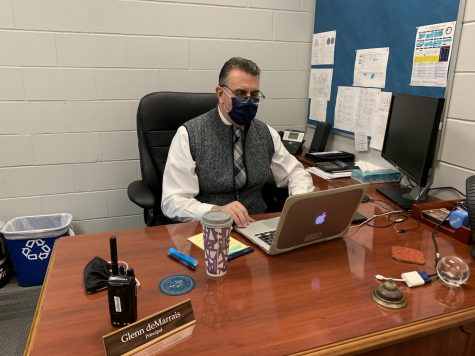 The 2020-2021 interim principal Glenn deMarrais sitting in his office.