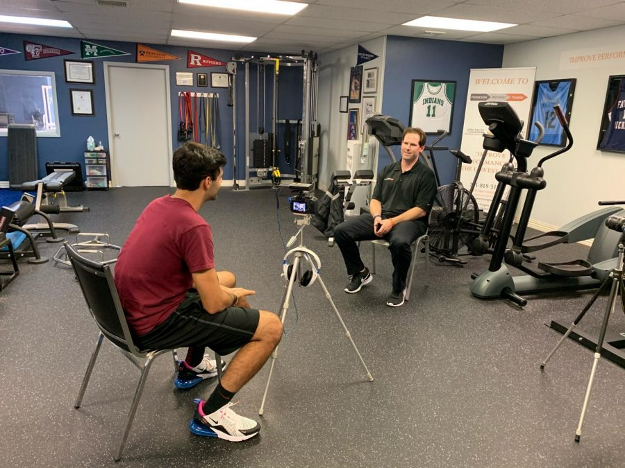 Andre Dabaghian filming with Mike Blackgrove. They created a documentary on his brother, John Blackgrove, to share his story called 'Two Way Player.'