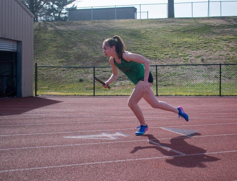 Junior Julianna Mullaney runs in the 4x400 meter relay for the track team. Mullaney along with  Shannon Connolly, Izzy Forcellati, and Tori Criscuolo are this week's Athletes of the Week.