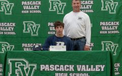 Senior Mason Baronian and coach Will Lynch participate in a signing ceremony for college-bound athletes. Baronian will be continuing his academic and athletic careers at Pace University.