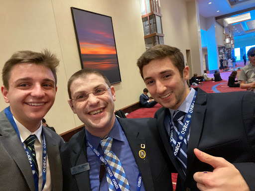 PV seniors Anakin Rybacki and Thomas DeWitt with NJ DECA State Advisor Jeffrey Victor at one of last year's in-person DECA events. This year, students could not attend in-person events due to COVID-19, and all events were all held virtually.