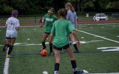 Celina Bussanich passes to her teammate as they prepare for the next game against Immaculate Heart at 2:00 on Saturday.