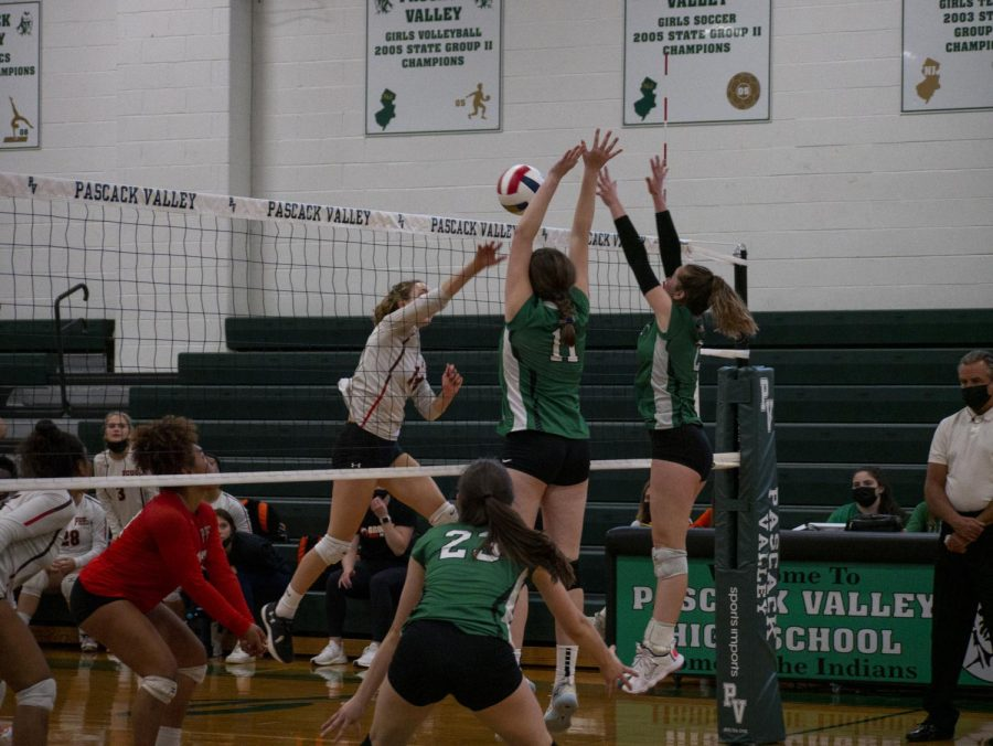 Both Taylor Grady and Sabrina Hirsch go up for the block, in the win on Friday against Hills.